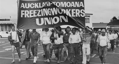 Photograph of freezing workers union holding banner and marching.