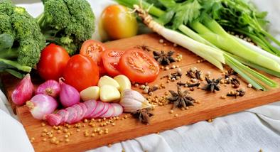 Fruits and vegetables on chopping board.