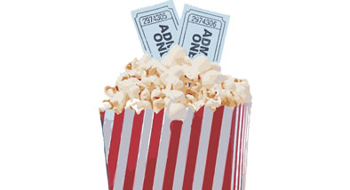 Movie popcorn with movie tickets