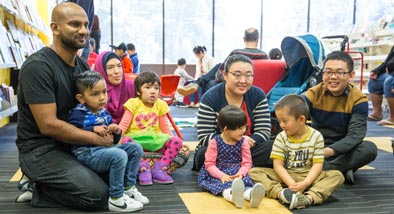 Group of parents and children posing at Storytime