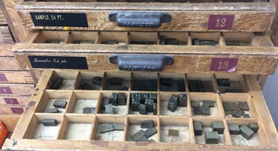 Set of drawers with letter press letters