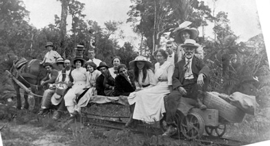 Old photograph of family on railway.