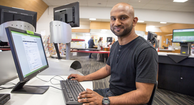 Man at a library computer