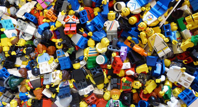 Lots of lego pieces and characters in a pile.