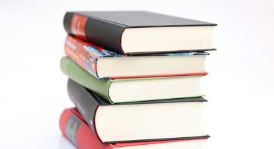 Stack of thick books on white background.