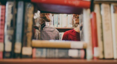 People seen through bookshelf