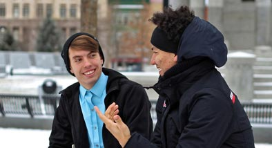 Two guys talking in winter clothing