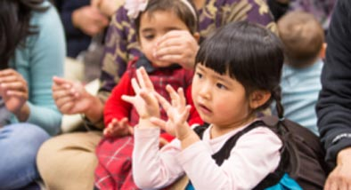 Small chinese girl doing hand movements