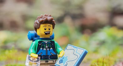 Lego hiker with compass and map