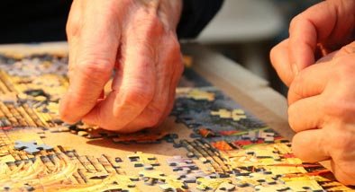 Two people doing a jigsaw puzzle