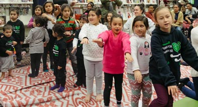 Children performing dance in line