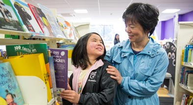 Chinese woman and granddaughter at the library